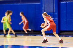 Girls athlete in sport uniform playing basketball Royalty Free Stock Photo