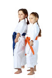 Girls athletes with orange and blue belt stand in rack Stock Images
