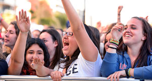 Girls from the audience in front of the stage, cheering on their idols at the Primavera Pop Festival of Badalona Stock Photo