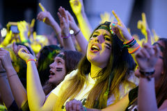 Girls from the audience in front of the stage, cheering on their idols at the Primavera Pop Festival Royalty Free Stock Images