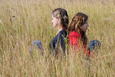 Girls in an autumn field Royalty Free Stock Photo