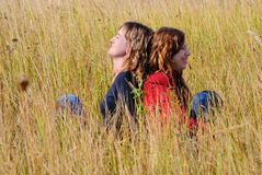 Girls in an autumn field Stock Image