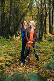 Girls in autumn forest Royalty Free Stock Images