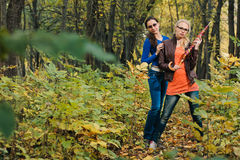 Girls in autumn forest Royalty Free Stock Photography