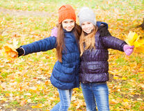 Girls at autumn Royalty Free Stock Image