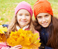 Girls at autumn Stock Images