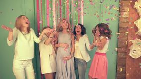 Girls on the Babyshower of the friend, they inflate confetti on all room.