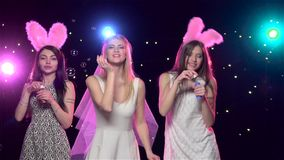Girls at bachelorette party blowing kisses, soap bubbles. Slow motion. Happy girls having fun at bachelorette party, blowing kisses and soap bubbles, against stock video footage