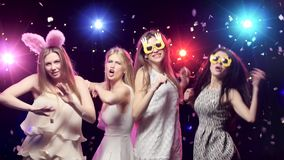 Girls at bachelorette party dancing and having fun. Girls at bachelorette party dancing, having fun, against disco lights. Bride with veil, girlfriends with stock video