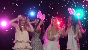 Girls at bachelorette party dancing and having fun. Slow motion. Girls at bachelorette party dancing and having fun, against disco lights, glitter confetti stock video footage