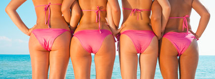 Girls back  on beach Stock Photography