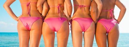 Girls back  on beach Stock Photography