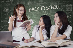Girls back to school and studying togehter Stock Photos