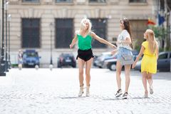 Girls are back in town. Lovely young women having fun in the city streets Stock Photo