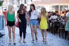 Girls are back in town. Lovely young women having fun in the city streets Stock Photography