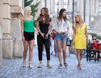 Girls are back in town. Lovely young women having fun in the city streets Royalty Free Stock Photo