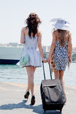 The girls on the background of the ocean liner Royalty Free Stock Photography