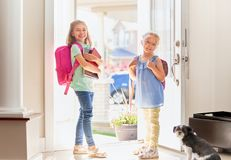 Girls with backpack is going to school Royalty Free Stock Image