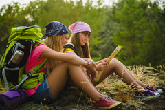 Girls with backpack Looing at map. Adventure, travel, tourism concept. Girls with backpack looing at map. Adventure and travel or tourism concept Stock Photography