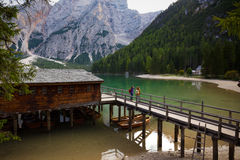 Girls backpacker looking at Braies lake royalty free stock images