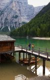 Girls backpacker looking at Braies lake stock images
