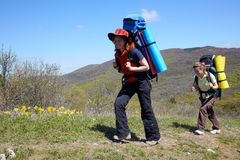 Girls with backpaks walking outdoor stock photo