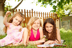Girls in the backyard Royalty Free Stock Image