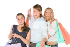 Girls With Bags. 3 girls with shopping bags. The girl in the center has got a metal braces on her teeth Royalty Free Stock Image