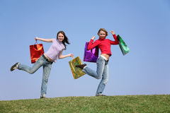 Girls with bags2 Royalty Free Stock Image