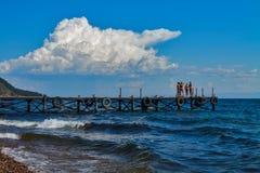 Girls in Baikal lake. Girls in swimming suits at pier at Baikal lake Stock Photos