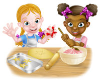 Girls Baking Cakes. Cartoon girls, one black one white, dressed as chefs or bakers baking cakes and cookies Royalty Free Stock Images