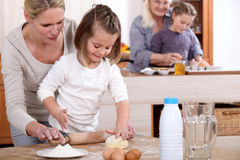 Girls baking with mum Royalty Free Stock Photography