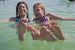 Girls balancing on the water in the Dead Sea Royalty Free Stock Photography