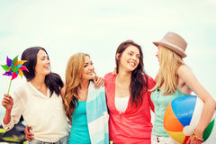 Girls with ball on the beach Stock Photography