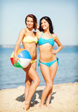 Girls with ball on the beach Stock Photo
