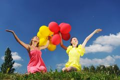 Girls with balloons Royalty Free Stock Images
