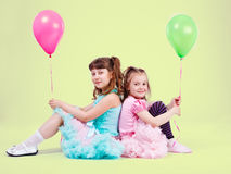 Girls with balloons Stock Photos