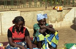 Girls, Bamako, Mali. Two girls are sitting in the market in the central part of Bamako, Mali Royalty Free Stock Photography