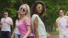 Girls band dancing for music video, young attractive people enjoying summertime. Stock footage stock video footage