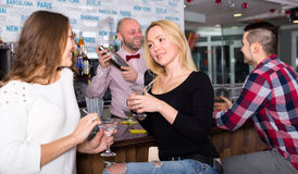 Girls at a bar Royalty Free Stock Photos