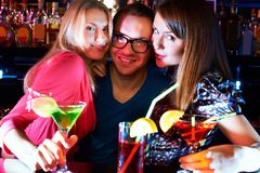 Girls and barman Royalty Free Stock Photos