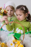 Girls with basket and flowrs playing Stock Photo