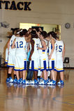 Girls basketball team huddle royalty free stock photography