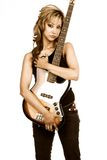 Girls with Bass. Hispanic Girl with brown electric bass guitar focus on gitara royalty free stock photo