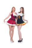Girls in bavarian costumes isolated on the white Royalty Free Stock Photo