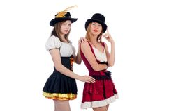 Girls in bavarian costumes isolated on the white Royalty Free Stock Image