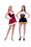 Girls in bavarian costumes isolated on the white Royalty Free Stock Images