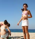 Girls on the beach. Three teen girls playing on the beach Stock Photography