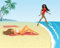 Girls on a beach Stock Photos