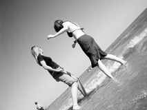 Girls at the beach. Girls playing on Frinton beach stock image